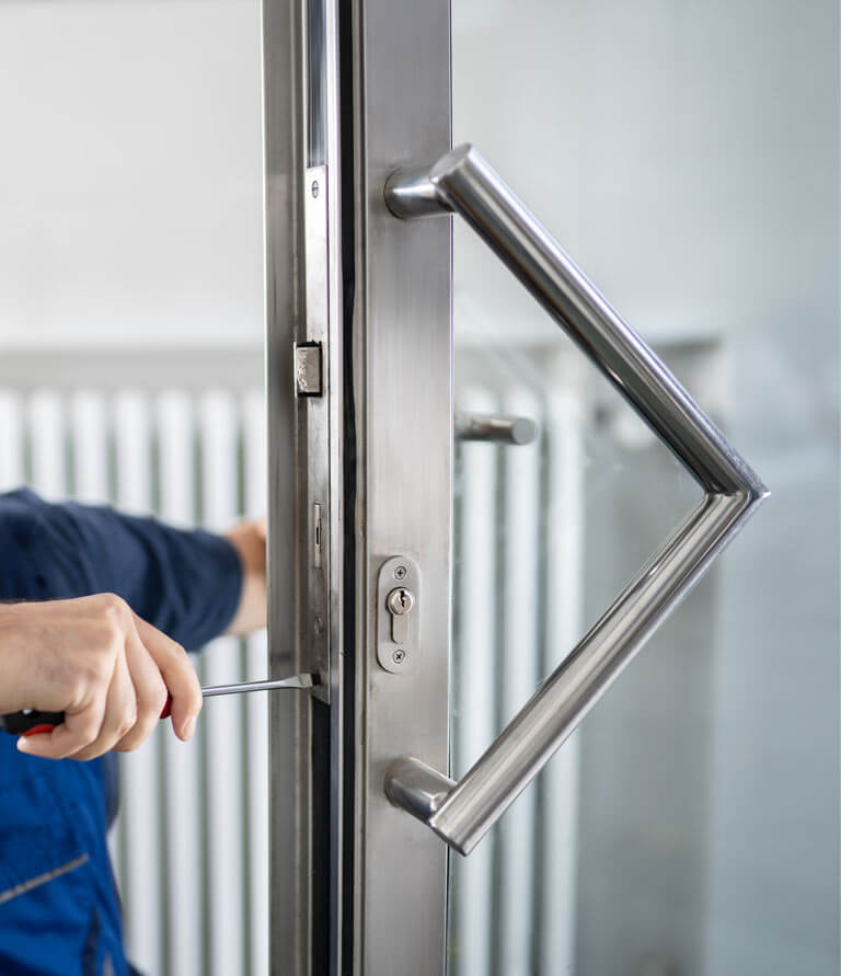 Locksmith changing locks on door